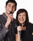 Het zingen van de man en van de vrouw stock foto's