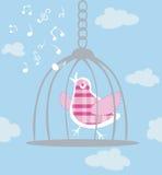 Het zingen van de vogel in kooi Stock Foto