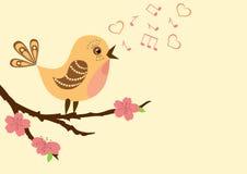 Het zingen vogel op een tot bloei komende tak. Stock Afbeeldingen