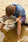 Het zoeken van goud Stock Fotografie