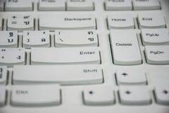 Het zoemende toetsenbord, tussen Enter en schrapt Stock Foto