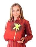 Het zoete jonge meisje met Kerstmis stelt voor Royalty-vrije Stock Foto's