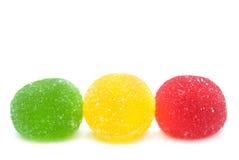 Het zoete suikergoed van de fruitkleur op wit stock afbeelding