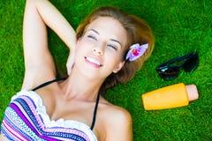 Het Zonnebaden van de vrouw Stock Foto