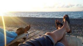 Het zonoverzees en ontspant stock afbeelding