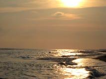 Het zonsondergangoverzees Stock Afbeeldingen
