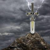 Het zwaard in de steen Stock Foto's