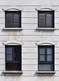 Het zwarte kader en shuttered venster Stock Afbeeldingen