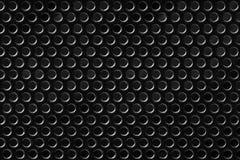 Het zwarte netwerk van het textuurmetaal met ronde gaten royalty-vrije stock afbeeldingen