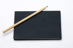 Het zwarte notaboek Royalty-vrije Stock Foto's