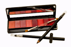 Het zwarte potlood van de oogvoering met lippenstift stock foto