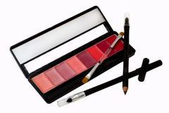 Het zwarte potlood van de oogvoering met open lippenstift Royalty-vrije Stock Foto