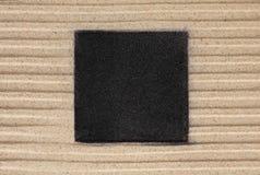 Het zwarte vierkant op het zand Royalty-vrije Stock Afbeeldingen