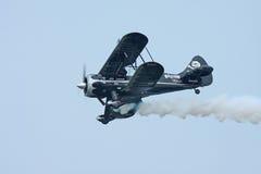 Het zwarte Vliegtuig van de Stunt Royalty-vrije Stock Afbeeldingen