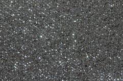 Het zwarte zilver schittert textuurachtergrond Royalty-vrije Stock Afbeeldingen