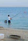 Het zwemmen en visserij stock foto