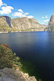 Hetch Hetchy Dome. Hetch Hetchy rises above the reservoir on a Spring day at Hetch Hetchy Reservoir in Yosemite National Park, California Stock Photo