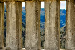 Hetch Hetchy lookout from the dam. In between concrete pillars. green brown rocky valley below. Historic Royalty Free Stock Images