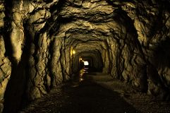 Hetch Hetchy Tunnel with light at the end. Dark inside. Passageway Royalty Free Stock Photos