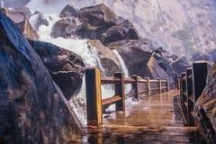 Hetch Hetchy Valley. Wooden bridge over a waterfall in Hetch Hetchy Valley, Yosemite National Park Royalty Free Stock Image