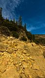 Hetch Hetchy Yosemite National Park. Hetch Hetchy Dam at Yosemite National Park with cloudy sky. panorama. rocks and geology. trees and mountain in the Stock Image