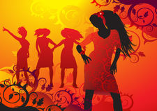 Hete aantrekkingskrachtmeisjes die op een bloemachtergrond dansen Royalty-vrije Stock Afbeelding