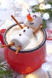 Hete chocolade met gesmolten sneeuwman royalty-vrije stock fotografie