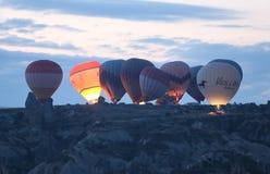 Hete Luchtballons in Cappadocia-Valleien Stock Foto