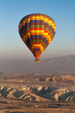 Hete Luchtimpuls over Cappadocia Stock Afbeeldingen