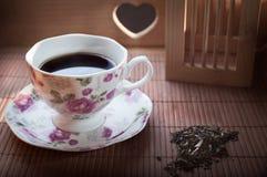 Hete thee in een porseleinkop Stock Afbeeldingen
