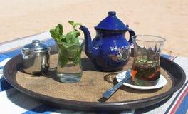 Hete thee ont hij strand Stock Foto