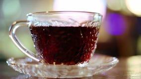 Hete zwarte thee stock footage