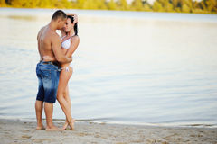 Heterosexual couple on beach next to river Royalty Free Stock Photography