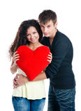 Heterosexual couple with a big heart. On white background Stock Photo