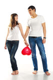 Heterosexual couple with a big heart. On white background Stock Image