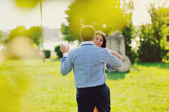 Heterosexual Couple dancing  in park Stock Photo