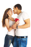 Heterosexual couple with a heart. Kissing heterosexual couple with a heart isolated on white background Stock Image