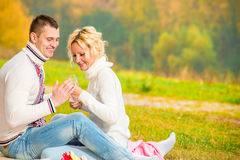 Heterosexual couple relaxing  in the park Stock Photography