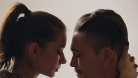 Heterosexual couple in studio stock video