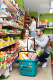Heterosexual couple at a supermarket Royalty Free Stock Photo