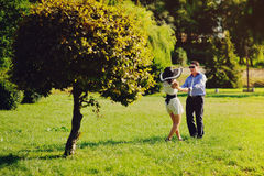 Heterosexual Couple walking in park Stock Photo