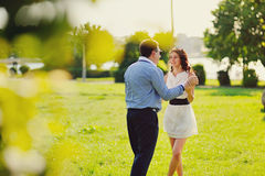 Heterosexual Couple walking in park Royalty Free Stock Image