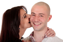 Heterosexual loving couple. Young Caucasian  heterosexual loving couple kissing each other,  Studio, white background Royalty Free Stock Images