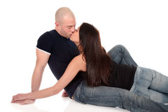 Heterosexual loving couple. Young Caucasian  heterosexual loving couple kissing each other,  Studio, white background Stock Images