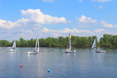 Hetman Cup 2016 Regatta, Dnipro river, Kiev, Ukraine, May 9, 2016. Unidentified yachtsmen are preparing for the regatta. Editorial Stock Photography