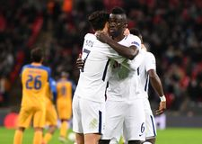 Heung-Min Son and Davinson Sanchez goal celebration. Football players pictured during the UEFA Champions League Group H game between Tottenham Hotspur and APOEL Royalty Free Stock Photos