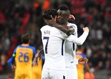 Heung-Min Son and Davinson Sanchez goal celebration. Football players pictured during the UEFA Champions League Group H game between Tottenham Hotspur and APOEL Royalty Free Stock Images