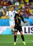 Heung-minuto do filho e Steven Defour Coupe du monde 2014 Fotografia de Stock Royalty Free