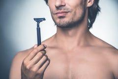 Heure pour le nouveau rasoir Photo stock