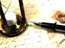 Heure pour une lettre images stock